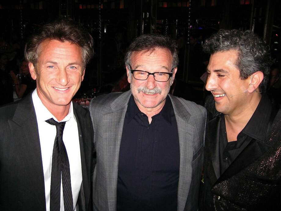 Sean Penn (left) with actor Robin Williams and comedian Frank Ferrante at Teatro ZinZanni for a fundraiser in support of Penn's J/P HRO. May 2010. Photo: Catherine Bigelow, Special To The Chronicle