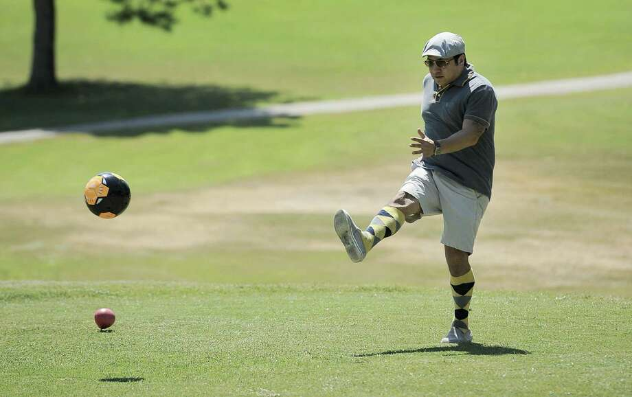 Greg Alfaro tees off during a round of FootGolf Friday at Willow Springs. Photo: Photos By Darren Abate / For The Express-News