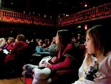 Theater and music series for children are gearing up for the fall season throughout Fairfield County. Above, two young theater-goers appear absorbed with a recent presentation at the Westport Country Playhouse. Contributed photo/Kathleen O'Rourke