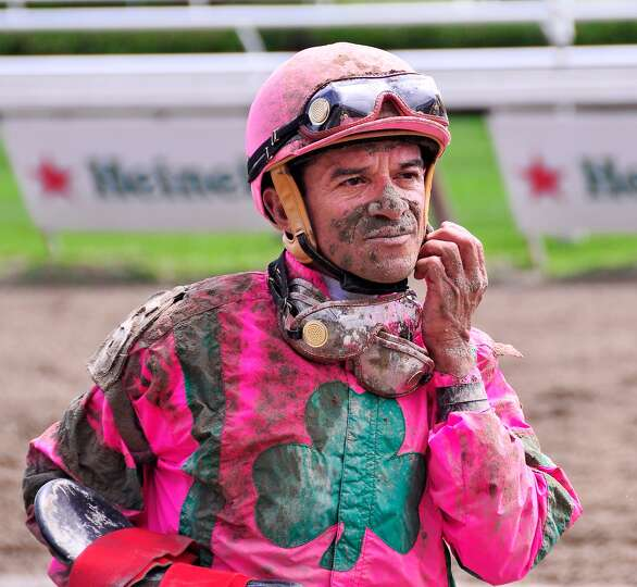 A muddy Cornelio Velasquez returns from a last place finish aboard Uncle Hugo during the first race