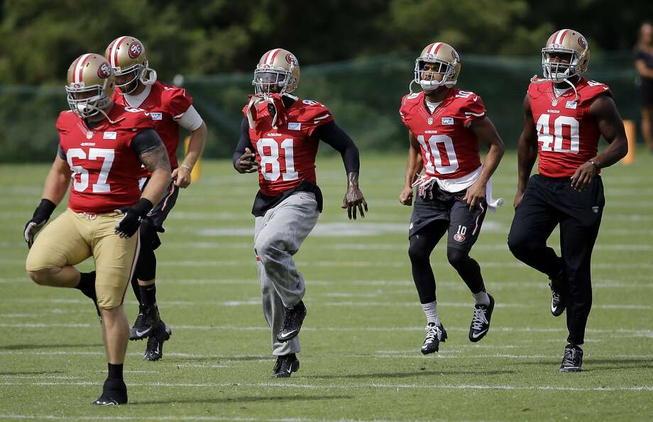 San Francisco 49ers wide receiver Anquan Boldin (81) warms up with guard Daniel Kilgore, from left, quarterback McLeod Bethel-Thompson, wide receiver David Reed and tight end Kevin Greene during an NFL football training camp practice, Monday, Aug. 11, 2014, in Owings Mills, Md. (AP Photo/Patrick Semansky) Photo: Patrick Semansky, Associated Press