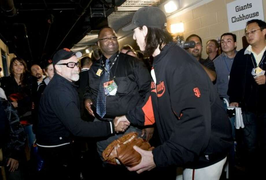 Actor Robin Williams congratulates Tim Lincecum after he struck out 14 leading the San Francisco Giants to a 1-0 victory over the Atlanta Braves in Game 1 of the National League Divisional Series at AT&T Park in San Francisco, Calif., on Thursday, October 7, 2010. Photo: Chad Ziemendorf, The Chronicle
