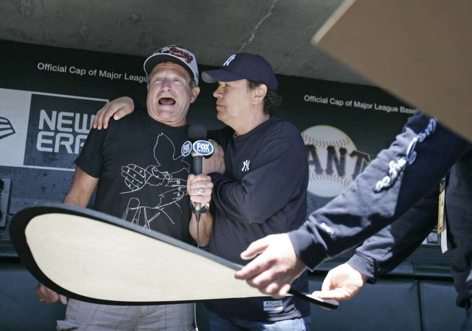 Comedians Robin Williams and Billy Crystal in the Giants dugout before a game in 2007. Photo: Deanne Fitzmaurice, SFC