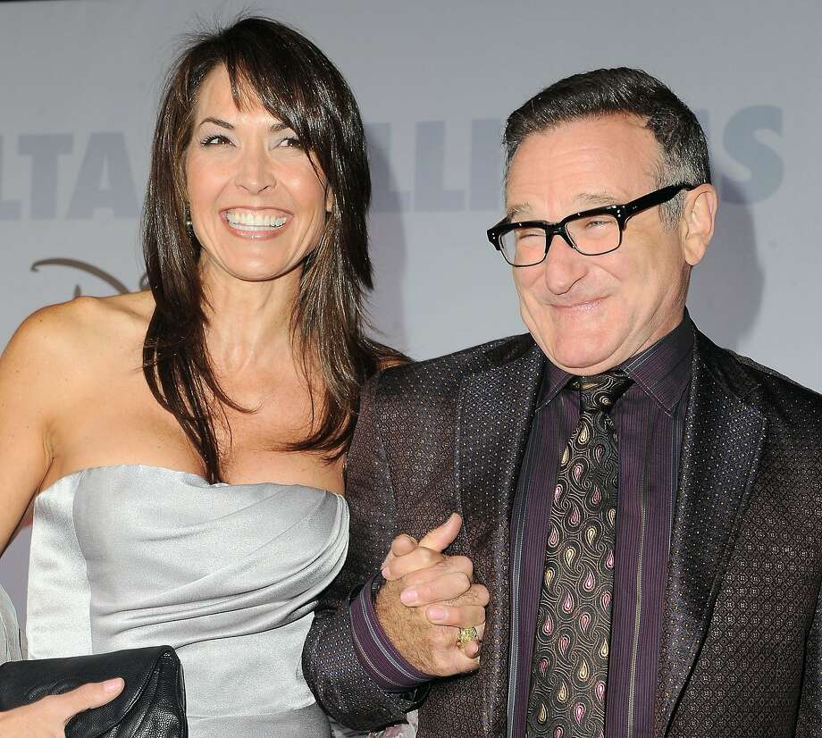 "This Nov. 9, 2009 file photo shows actor Robin Williams, right, and  his wife Susan Schneider at the premiere of ""Old Dogs"" in Los Angeles. Williams, whose free-form comedy and adept impressions dazzled audiences for decades, died Monday, Aug. 11, 2014, in an apparent suicide. Williams was 63. Photo: Katy Winn, Associated Press"