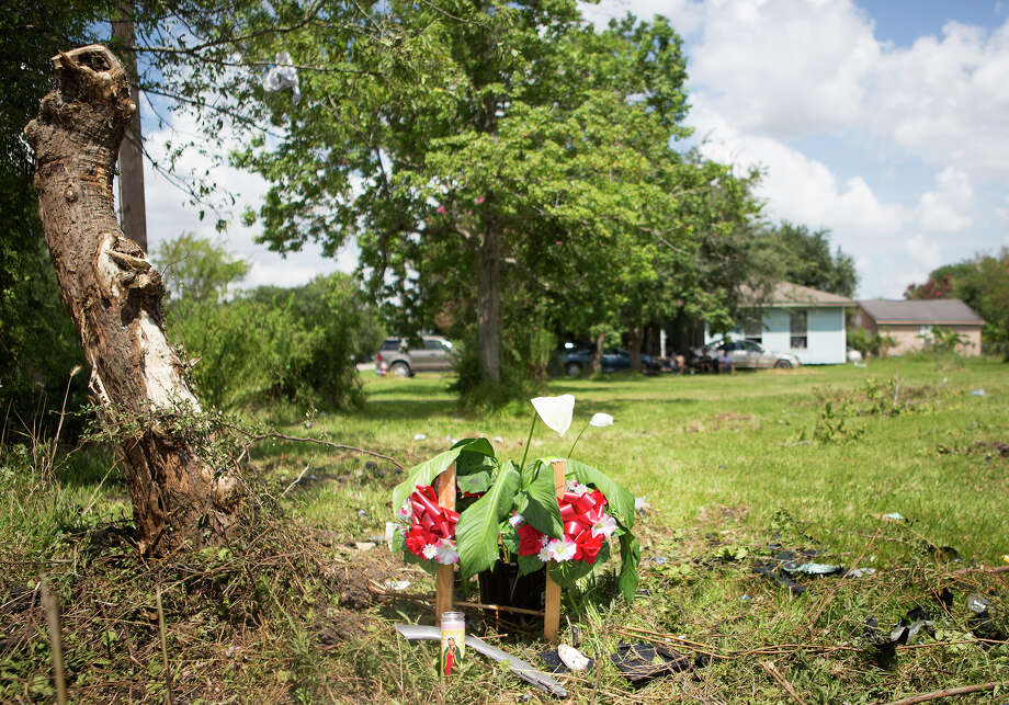 A make-shift memorial has been placed at the site of a two-vehicle crash that claimed the lives of six people in League City on Sunday. Photo: Cody Duty, Staff / © 2014 Houston Chronicle