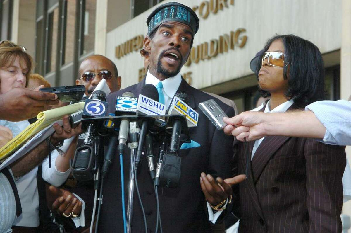Former Senator Ernie Newton (center) talked to the press after pleading guilty to three counts Sept. 20th, 2005 at the federal courthouse on Lafayette Street in Bridgeport. Ernie's sister Patricia Newton-Foster is at right.