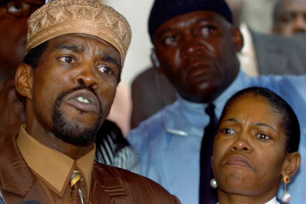 Ernest Newton III announces his intention to resign as state Senator on the steps of Bridgeport City Hall on Sept. 15th, 2005. He is seen here with his sister Patricia Newton-Foster.