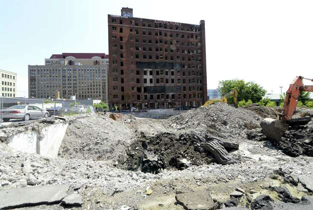 Demolition for the Albany's new convention center commences Monday, Aug. 11, 2014, on Eagle and Howard St. in Albany, N.Y. (Will Waldron/Times Union) Photo: WW / 00028122A