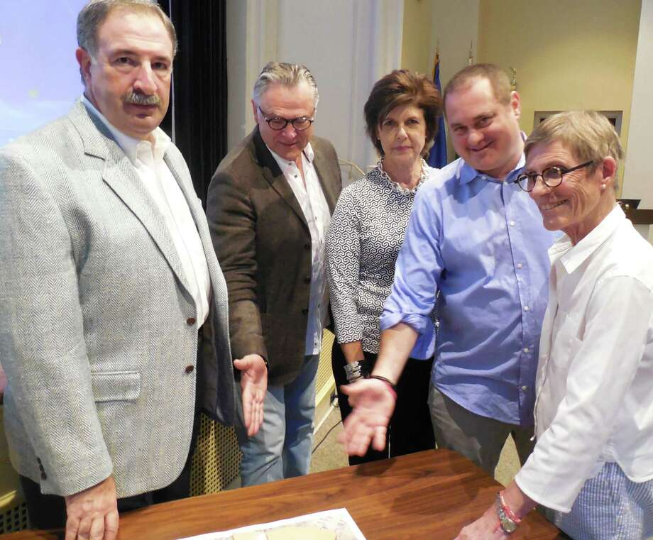 Members of the Westport Cinema Initiative look over a rendering of plans for a downtown movie theater prior to a special meeting of the Downtown Steering Committee Monday night. Members are: (from left) state Rep. Jonathan Steinberg, president; David Feig, treasurer; Susan Iseman, secretary; Doug Tirola, vice president and Sandy Lefkowitz, executive director. Photo: Anne M. Amato / westport news