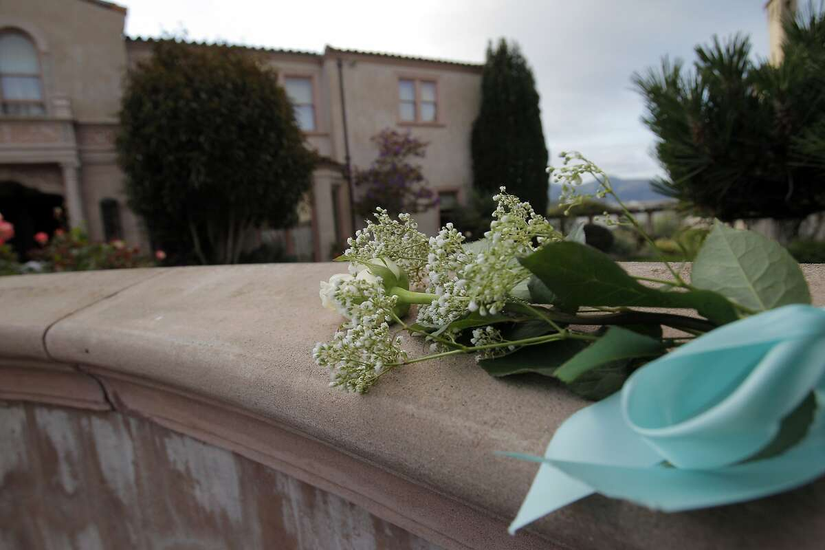 A flower lies atop the fence at Robin Williams' former home in the Sea Cliff neighborhood in San Francisco, Calif., on Monday, August 11, 2014. Williams was found dead in his Tiburon home earlier in the day and fans and friends left flowers and notes to honor the comedy and acting legend.