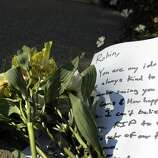 A small bouquet of flowers and note were placed at the front gate at Robin Williams' former home in the Sea Cliff neighborhood in San Francisco, Calif., on Monday, August 11, 2014. Williams was found dead in his Tiburon home earlier in the day and fans and friends left  flowers and notes to honor the comedy and acting legend.