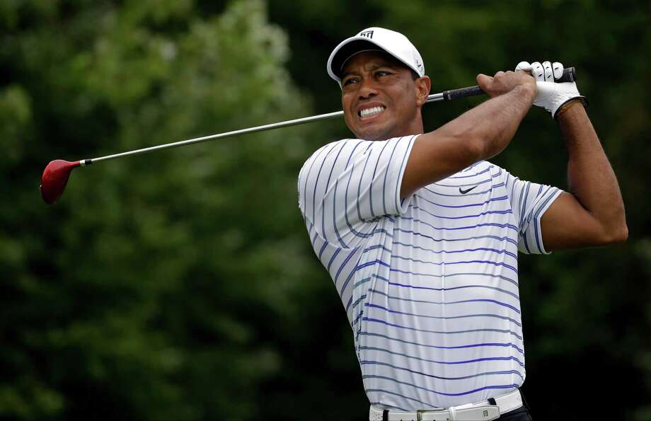 Tiger Woods winces after tee shot on the sixth hole during the second round of the PGA Championship golf tournament at Valhalla Golf Club on Friday, Aug. 8, 2014, in Louisville, Ky. (AP Photo/Jeff Roberson)  ORG XMIT: KYDC198 Photo: Jeff Roberson / AP