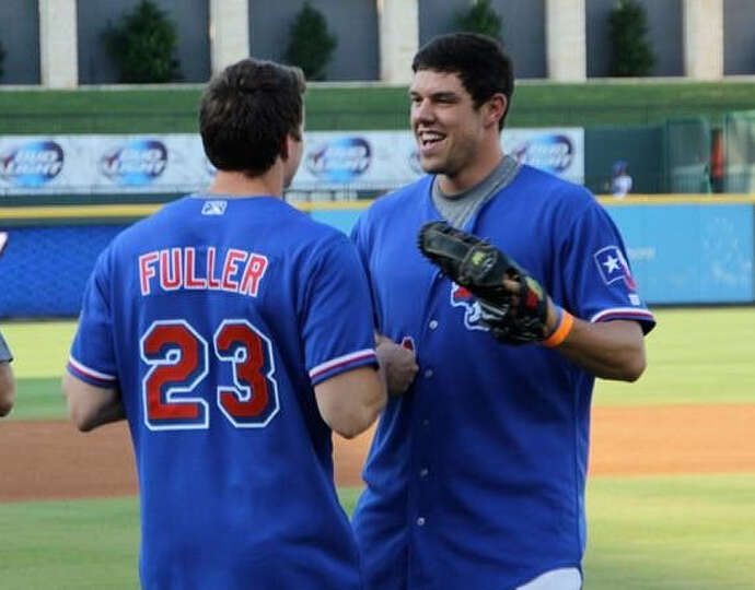 Baylor quarterback Bryce Petty (right), who threw out the first pitch, helped with Clay Fuller's pro
