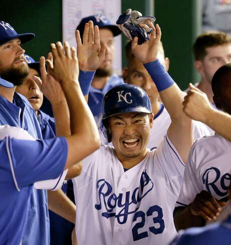The Royals' Norichika Aoki (23) is all smiles in the dugout after scoring the go-ahead run in the seventh inning of Monday's game against the Athletics. Kansas City held on for a 3-2 victory, its eighth in a row, pushing it past the Tigers for the top spot in the AL Central. Photo: Charlie Riedel, STF / AP