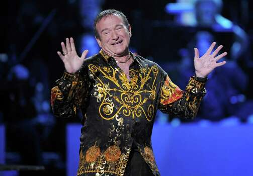 "This April 6, 2008 file photo shows actor-comedian Robin Williams speaks on stage at the ""Idol Gives Back"" fundraising special of ""American Idol"" in Los Angeles.  Photo: Mark J. Terrill / AP"
