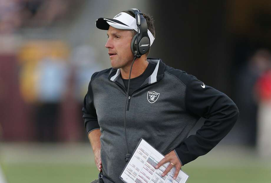 Oakland Raiders head coach Dennis Allen watches against the Minnesota Vikings in the first half of a preseason NFL football game at TCF Bank Stadium in Minneapolis, Friday, Aug. 8, 2014. (AP Photo/Jim Mone) Photo: Jim Mone, Associated Press