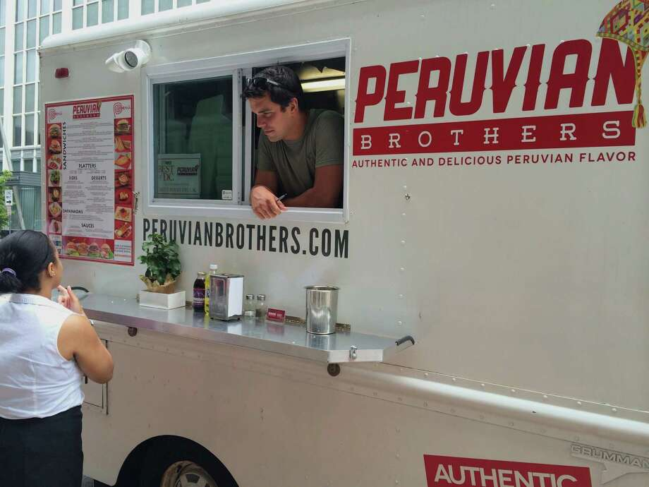 Giuseppe Lanzone talks with a customer at his Peruvian Brothers food truck in Washington, D.C., which accepts bitcoin for payment.  Photo: Adrienne Lu, MBR / Stateline.org