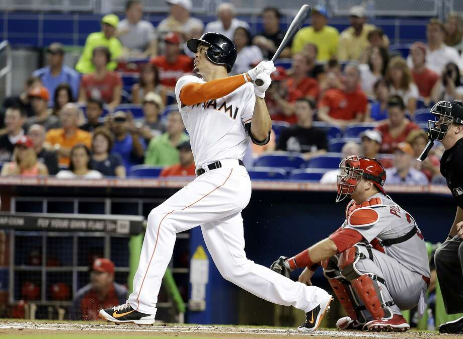Giancarlo Stanton hit two home runs and made a spectacular diving catch in right field to help the Marlins beat the Cardinals 6-5 on Monday night. Photo: Lynne Sladky, Associated Press