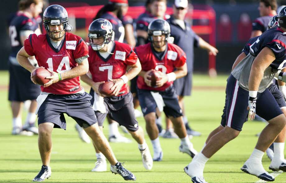 Texans quarterbacks Ryan Fitzpatrick (left), Case Keenum (center) and Tom Savage run a drill during Monday's practice. Photo: Brett Coomer / Houston Chronicle / © 2014 Houston Chronicle