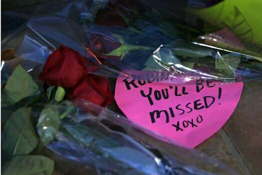 A heart-shaped note and several bouquets of flowers lay in front of the home of Robin Williams in Tiburon, Calif. on Monday, August 11, 2014. Photo: Scott Strazzante, The Chronicle