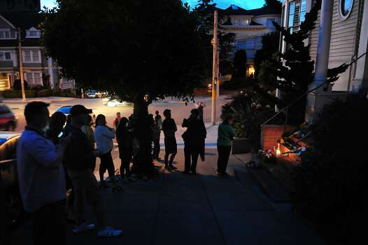 "Mourners pay respects to Robin Williams outside the house where he made ""Mrs. Doubtfire"" in San Francisco's Pacific Heights. Photo: Craig Hudson, The Chronicle"