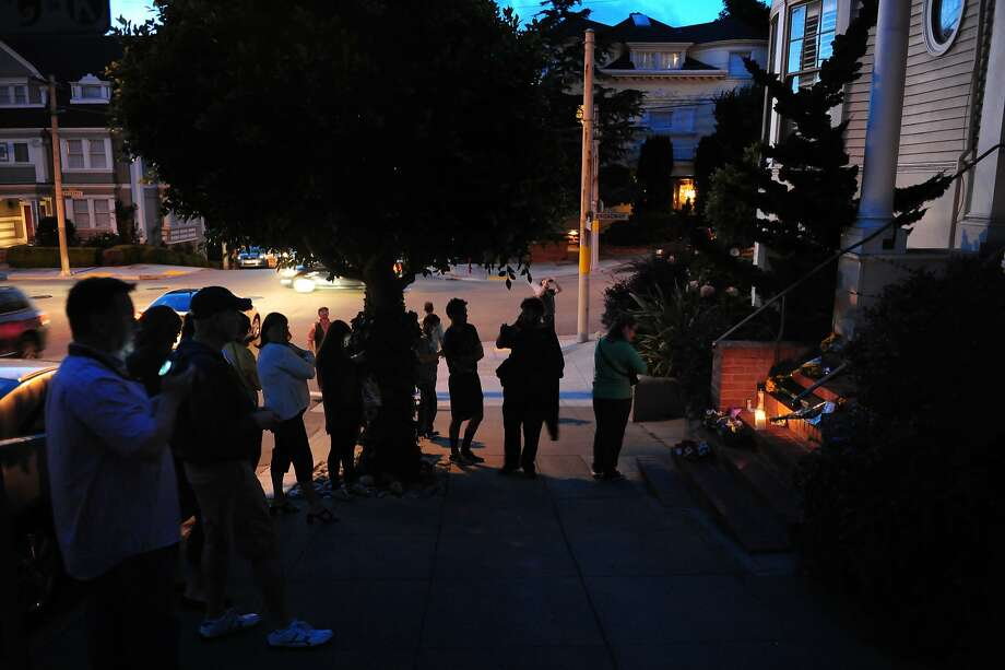 People pay respects to comedian and actor Robin Williams outside the Mrs. Doubtfire house on August 11, 2014 in San Francisco, CA. Robin Williams was found dead this morning in his Tiburon home. Photo: Craig Hudson, The Chronicle