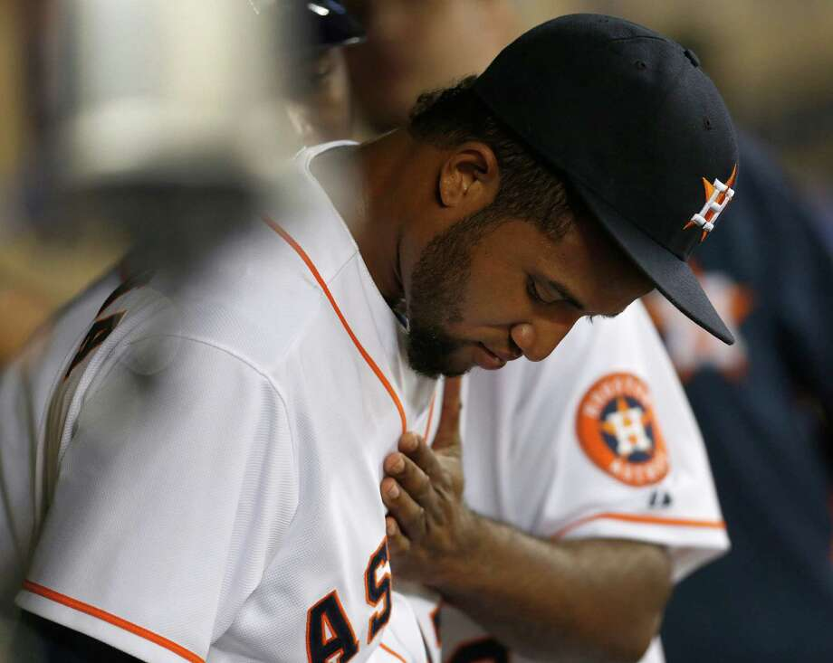 Rookie Domingo Santana needed to be consoled after his ninth-inning mental lapse in the outfield cost the Astros a run. Photo: Karen Warren, Staff / © 2014 Houston Chronicle