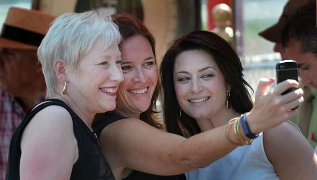 SUNY Chancellor Nancy L. Zimpher, left takes part in a selfie with two of her associate chancellors; Stacy Hengsterman, center and Jen Lotruco, right before the running of State University of New York race Aug. 11, 2014  at the Saratoga Race Course in Saratoga Springs, N.Y.     (Skip Dickstein/Times Union) Photo: SKIP DICKSTEIN