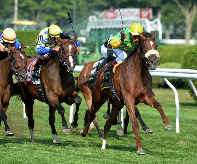 Miss Frost ridden by jockey Edgar Prado boldly moves away from the field to win the 1st running of T