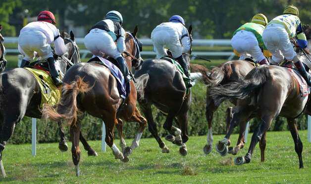 The field heads for the clubhouse turn in the early portion of the 1st running of The Tenski stake Aug. 11, 2014  at the Saratoga Race Course in Saratoga Springs, N.Y.     (Skip Dickstein/Times Union) Photo: SKIP DICKSTEIN