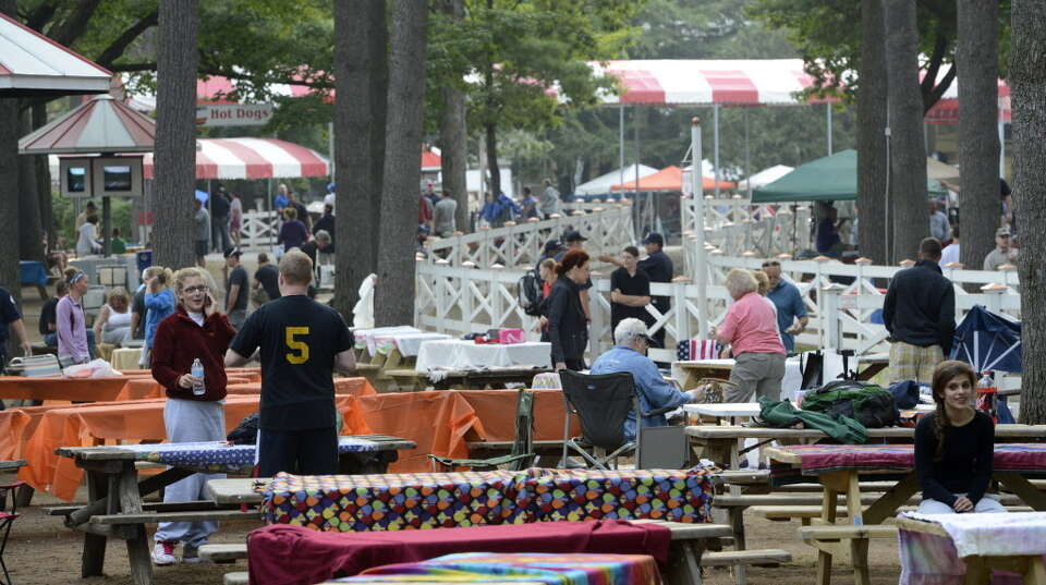Covered picnic tables are place holders in the picnic area at the Saratoga Race Course  in Saratoga