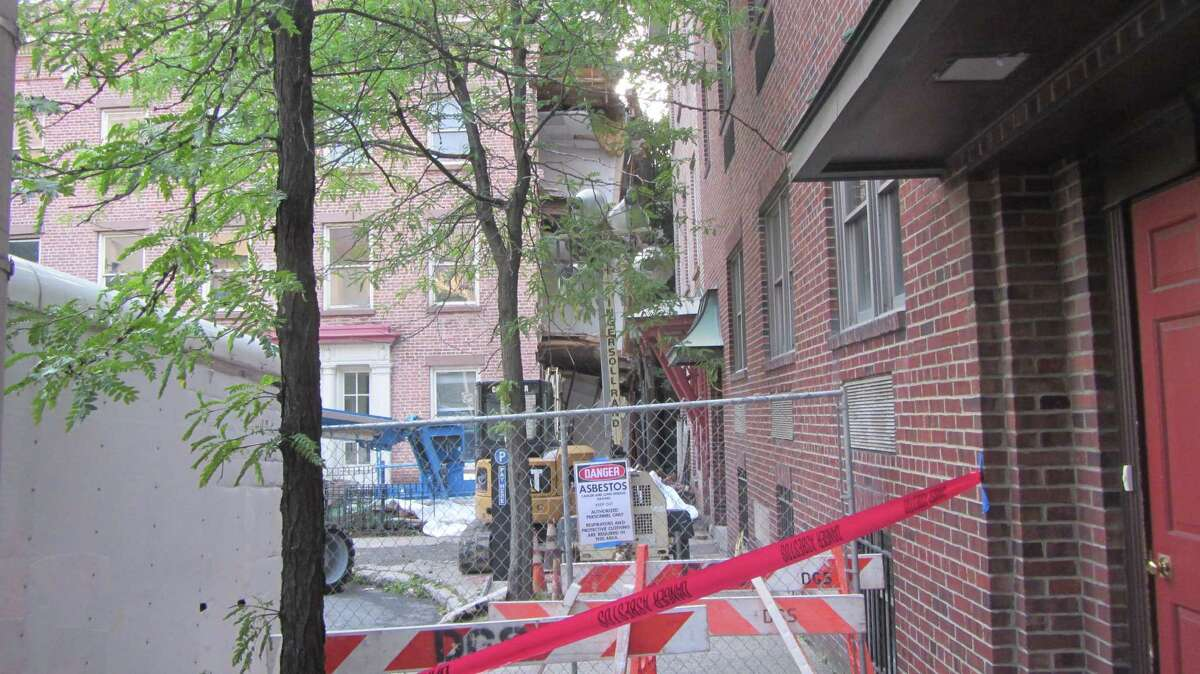 The side of a building collapsed on 1 Columbia Place, Albany, is shown on Tuesday, Aug. 12, 2014. (Bob Gardinier/Times Union)