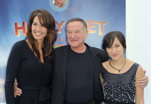 "Robin Williams, with his daughter, Zelda Williams, right, and third wife Susan Schneider arrive at the premiere of  ""Happy Feet Two"" at Grauman's Chinese Theater in 2011. Photo: Katy Winn, Wire Photo / AP2011"