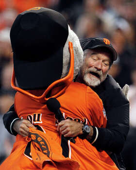 In this file photo from Thursday, Oct. 7, 2010, actor Robin Williams hugs San Francisco Giants mascot Lou Seal during the first inning of Game 1 of baseball's National League Division Series in San Francisco. Photo: Ben Margot, Wire Photo / AP