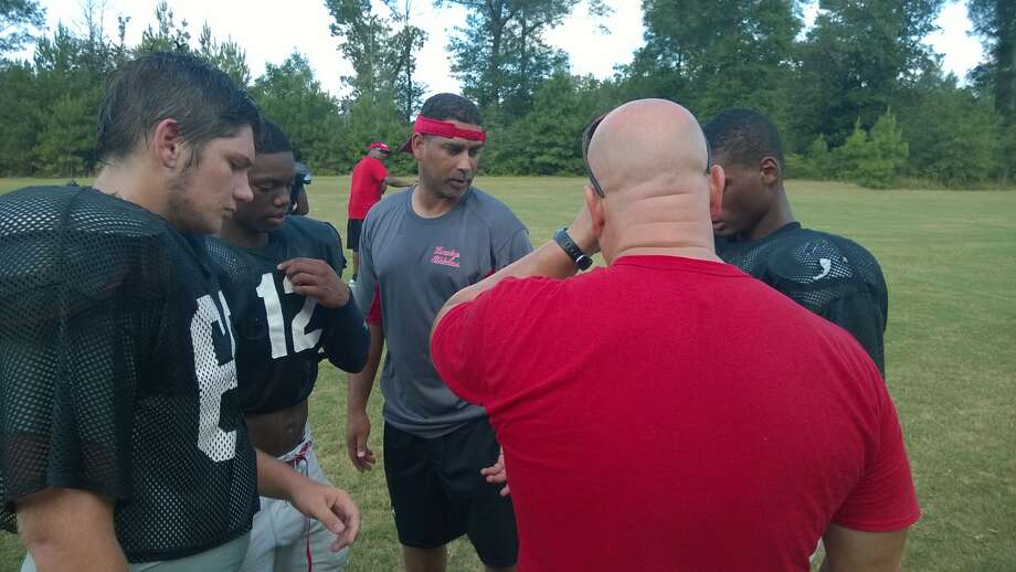 Kountze's Duane Joubert instructs the offense during practice on Monday. Photo take Monday, August 11, 2014 Kendrick Johnson/@kendrickjohnso Photo: Kendrick Johnson, Reporter