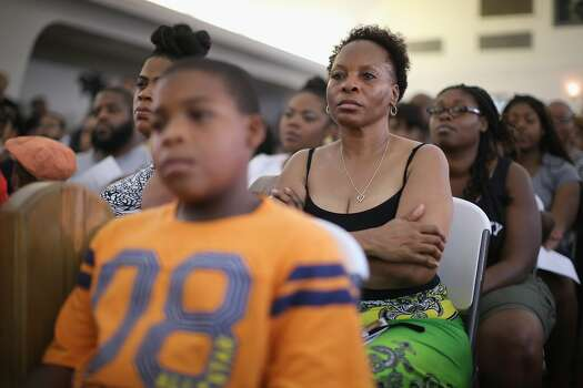 Guests listen to speakers during at a town hall meeting hosted by the St. Louis County NAACP at Murchison Tabernacle Church to discuss the killing of 18-year-old Mike Brown and the community unrest that followed his death on August 11, 2014 in St. Louis, Missouri. Brown, who was reported to be unarmed, was shot and killed by a police officer on Saturday in suburban Ferguson, Missouri. Yesterday 32 arrests were made after protests over the shooting turned into rioting and looting in Ferguson.  Photo: Scott Olson, Getty Images