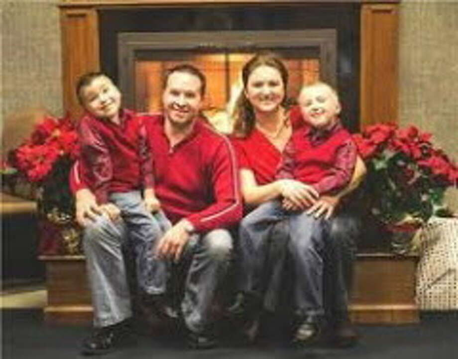 State Trooper David Cunniff, who was killed in December in a traffic accident, is shown in a family photo with his wife, Amy, and their sons Caleb and Zachary. (Provided photo)