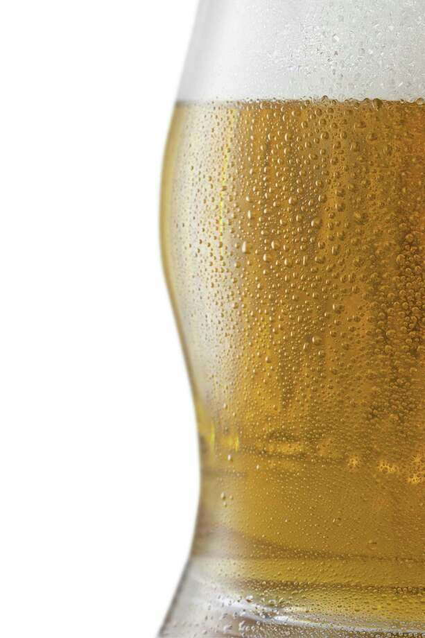 Bubbles and foam in a beer / iStockphoto
