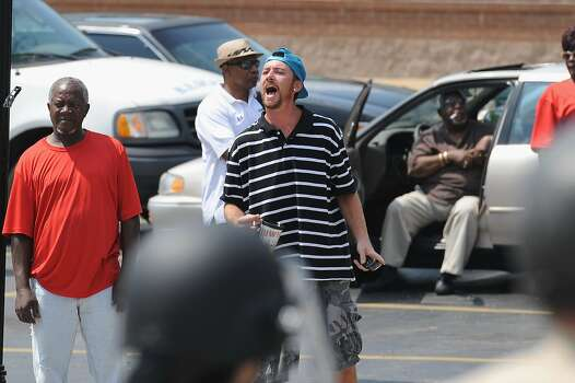 A man voices his outrage during a protest of the shooting death of 18-year-old Michael Brown outside Ferguson Police Department Headquarters August 11, 2014 in Ferguson, Missouri. The fatal shooting by police of the unarmed teen in Ferguson, Missouri has sparked outrage in the community and set off civil unrest including looting and vandalism. Photo: Michael B. Thomas, Getty Images