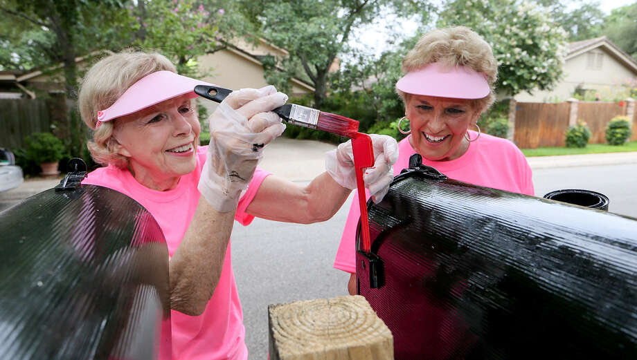 Mary Pruess (left) and Lee Wilkins paint mailboxes in the Gardens of Oak Hollow off of Jones-Maltsberger July 24. They charge $10 each for the local homeowners association. Photo: Marvin Pfeiffer / Stone Oak Weekly / EN Communities 2014