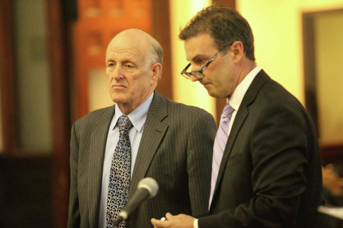 The Stratford Baptist church has fired its pastor of 16 years, Robert Genevicz, following allegations he stole from parishioners. Genevicz, left, appears in court with Attorney Fred Paoletti, Jr. in Bridgeport, Conn. on Monday, March 31, 2014.