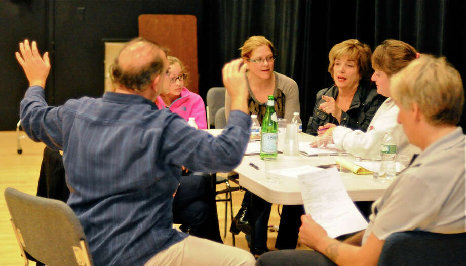 "The Darien Arts Center Stage committee discusses the upcoming production of the 2009 Tony Award winner ""God of Carnage."" Auditions for the show will take place Aug. 23 and 24. Photo: Contributed Photo, Contributed / Darien News"