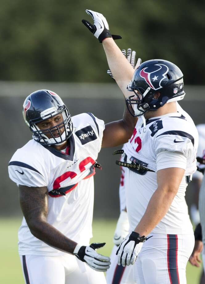 Defensive ends Keith Browner (98) and Jared Crick (93) work on pass rush drills. Photo: Brett Coomer, Houston Chronicle