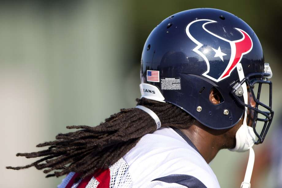 Linebacker Jadeveon Clowney wears a #Quessenberrystrong bracelet to tie his hair back. The bracelet honors Texans offensive tackle David Quessenberry, who is battling cancer. Photo: Brett Coomer, Houston Chronicle