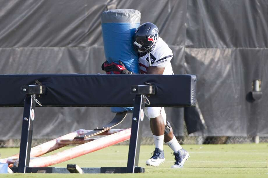 Defensive tackle Louis Nix III hits a blocking sled. Photo: Brett Coomer, Houston Chronicle