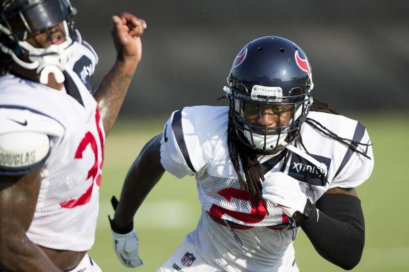 Texans free safety Kendrick Lewis, right, covers strong safety D.J. Swearinger in a pass coverage dr