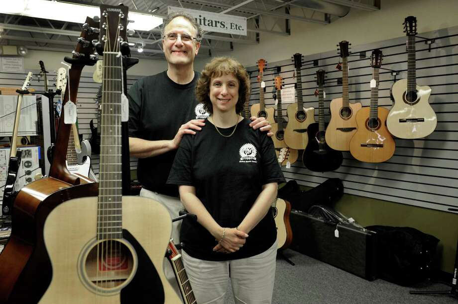 Bruce, 58, and Dana, 56, Treidel of New Fairfield, Conn., own the Bethel Music Center on Greenwood Ave. in Bethel. They are celebrating 30 years in business. Monday, August 11, 2014. Photo: Carol Kaliff / The News-Times