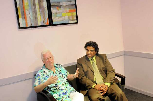 Patient Charlotte Hall, left, and Dr. Arvind Mahatme of Ellis Breast Surgery on Tuesday, July 29, 2014, at Ellis Health Center in Schenectady, N.Y. (Cindy Schultz / Times Union) Photo: Cindy Schultz / 00027865A