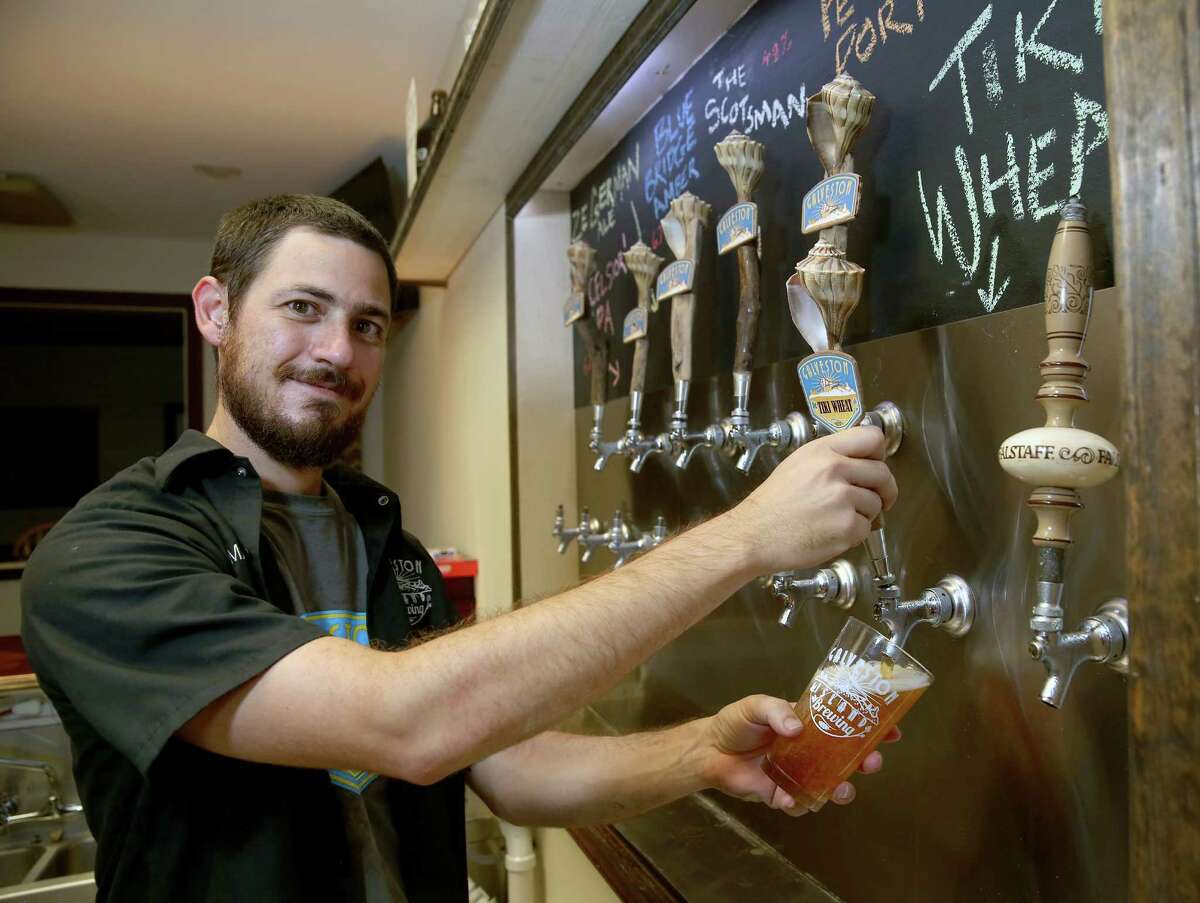 With a small staff, Galveston Island Brewing Co. owner Mark Dell'Osso makes and sells beer by the pint and by the growler to go.