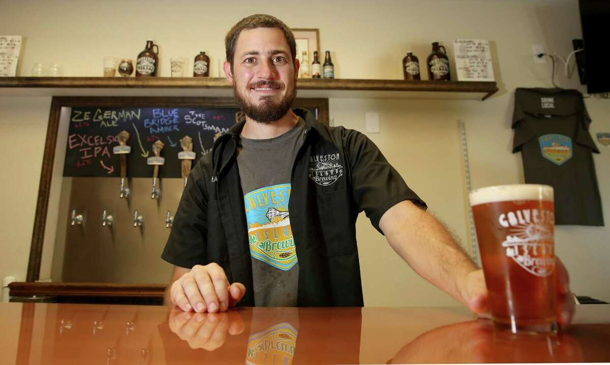 Brewmaster and owner Mark Dell'Osso pours a pint of Perdido Porter at the Galveston Island Brewing Co located at 8423 Stewart Road , Galveston.
